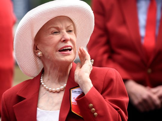 "FILE - In this Aug. 28, 2015 file photo Marylou Whitney of Marylou Whitney Stables talks to reporters after being inducted to the New York Racing Association 2015 Saratoga Walk of Fame during the annual Red Jacket Ceremony at Saratoga Race Course in Saratoga Springs, N.Y. Philanthropist, socialite and horse-racing enthusiast Marylou Whitney, known as the ""Queen of Saratoga,"" has died at her Saratoga Springs estate after a long illness. She was 93. The New York Racing Association announced Whitney's death on Friday, July 19, 2019 at Saratoga Race Course. (AP Photo/Hans Pennink, file)"