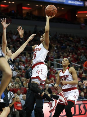 U of L's Asia Durr, #25, scores against Duke during the first half of their game at the KFC Yum! Center.Jan. 10, 2015
