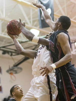 Niceville's Kameron Parker (23) shoots against Tate High School during the District 1-8A semifinal basketball game at Navarre High School on Tuesday, February 7, 2017.
