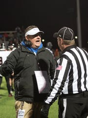 Southeastern coach Evan Gallaugher talks with a referee