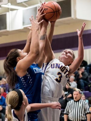 Unioto's Summer Sigman battles with Chillicothe's Shawnee Smith for a rebound during a 63-46 win over the Cavaliers on Dec. 9, 2017. The Shermans host Vinton County in a non-conference battle Wednesday night.