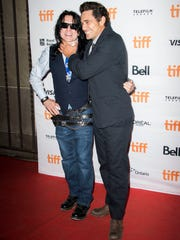 Tommy Wiseau, left, and James Franco attend a premiere