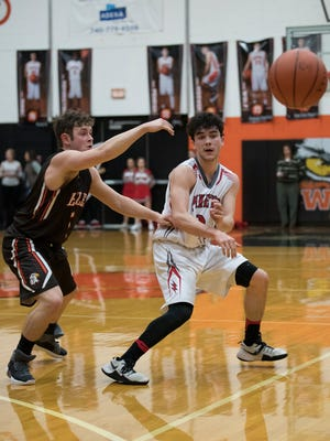 Piketon's Tanner Perdue passes to a teammate during Friday's 69-62 loss to Eastern at Waverly's Downtown Gym in the semifinals of the Pike County Holiday Classic.