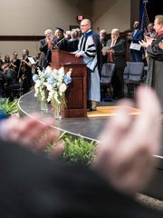 Dr. Jon S. Kulaga receives a standing ovation before giving his inaugural address as president of Ohio Christian University Wednesday morning in Circleville, Ohio.
