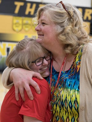 Jody Swingle hugs Cydnee Skaggs after Paint Valley's academic signing assembly. Cydnee plans on going to Wittenberg University to further her education.