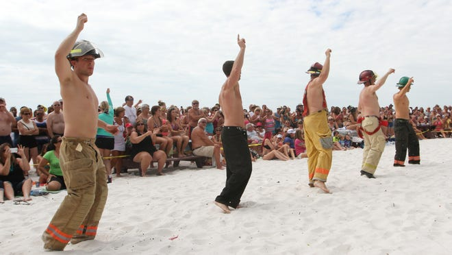 The Cincinnati Firefighters perform for crowds at the Lani Kai on Sunday during their daily revue for the purpose of raising money for the Araba Shriners.
