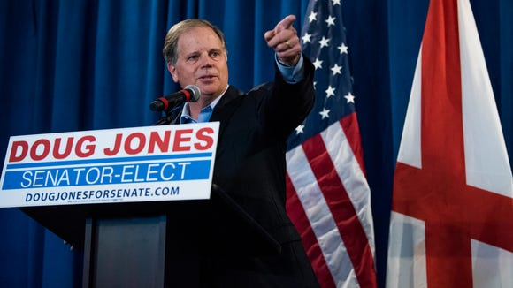 Senator elect Doug Jones holds a day after election