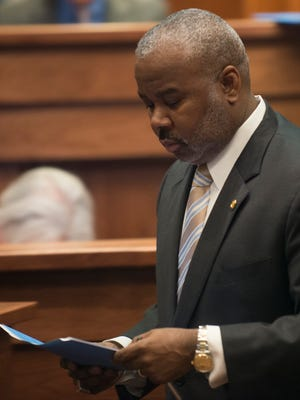 Alabama Senator Quinton Ross, D-Montgomery, walks to his seat during the 2016 Alabama legislative session on Tuesday, March 8, 2016, at the State House building in Montgomery, Ala.