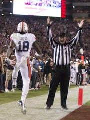 Auburn wide receiver Sammie Coates (18) celebrates