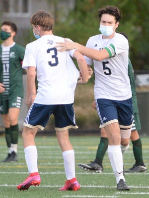 East Bridgewater's Ben Higgins, right, scores a goal against Abington, on Tuesday, Oct. 20, 2020.