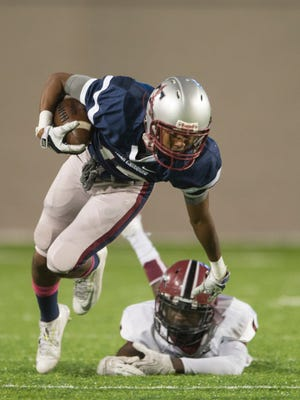 Park Crossing wide receiver Jahod Booker (19) breaks a tackle Stanhope defensive back Desmond Battle (1) during the game between Park Crossing High and Stanhope Elmore High on Thursday, Oct. 23, 2014, at the Cramton Bowl in Montgomery, Ala.