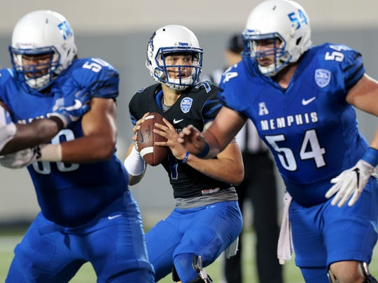 Memphis quarterback Brady Davis looks for an open man