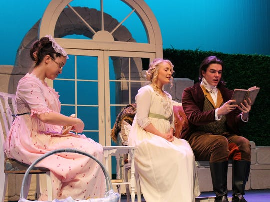"Marianne Dashwood (Kasey Birchfield) listens to Edward Ferrars (Andrew Gilliland) read, then offers advice in this rehearsal scene from ""Sense & Sensibility,"" Abilene Christian University's winter romance that opens Friday."