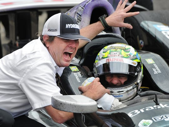 Jimmy Vasser celebrates with driver Tony Kanaan in Victory Circle after winning his first Indianapolis 500 race at the Indianapolis Motor Speedway Sunday, May 26 2013.