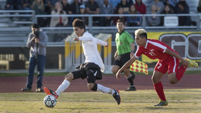 Golden West's Richard Chavez scores against Santa Maria's Edgar Garces in a CIF SoCal Regional first-round playoff game on Tuesday, March 7, 2017.