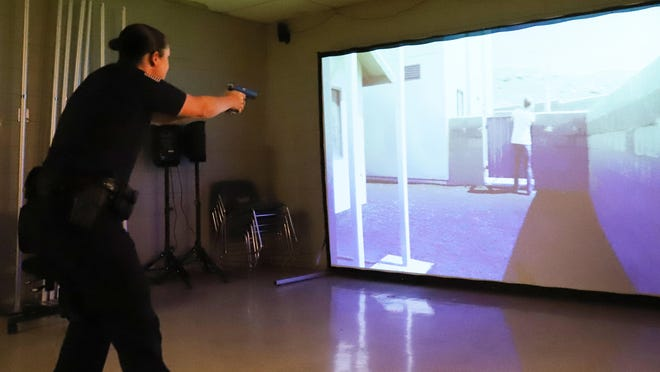 Fort Smith police officer Robyn Shoptaw goes through the Force Simulator, Thursday, Sept. 24, before members of the Citizen's Police Academy have the opportunity to try their skills in one of the training scenarios at the FSPD Training Center.