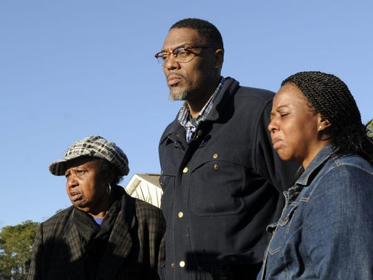 The family of missing Jayden Morrison, from left, his grandmother, Carolyn Sumpter, father, Andre Morrisob and mother Tabatha Morrisob look on in Little River, S.C., on Thursday, Dec. 25, 2014.