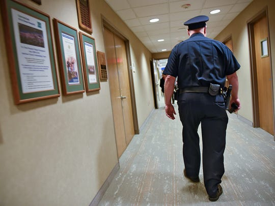 St. Cloud Police Department Commander Jim Steve walks down a hallway Friday, Oct. 14, at the St. Cloud Hospital. Steve works with the hospital on security issues and its interaction with the department.