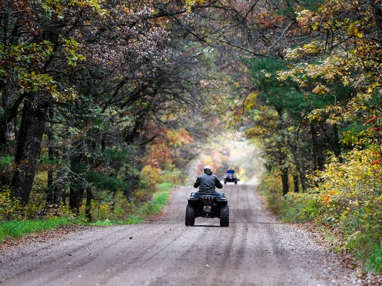 ATV riders make their way to trails following a meeting on proposed trail extensions near Camp Ripley and Little Falls Friday, Oct. 7, on an ATV trail near Randall.