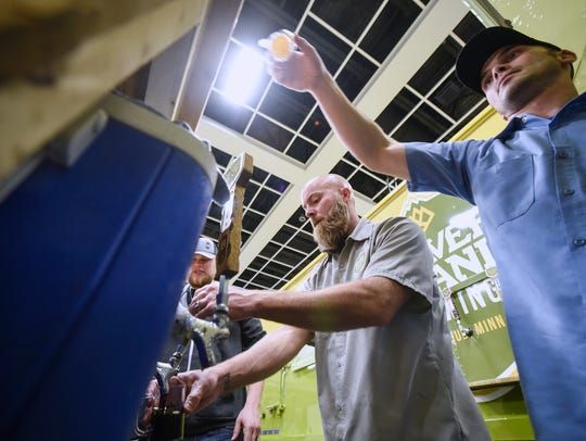 Beaver Island Brewing beer is served to long lines of patrons during the 2017 St. Cloud Craft Beer tour at the River's Edge Convention Center in St. Cloud.