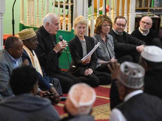 Bishop Donald Kettler and members of the Greater St. Cloud Area Faith Leaders present a letter of support in 2017 at the Central Minnesota Islamic Center in St. Cloud.