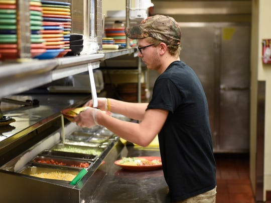 Cook Mitchell Koenig prepares food during the lunch hour in the kitchen Tuesday, May 9, at Mexican Village in St. Cloud. Mexican Village was featuring in a 2017 Times article for their successful restaurant inspection record.