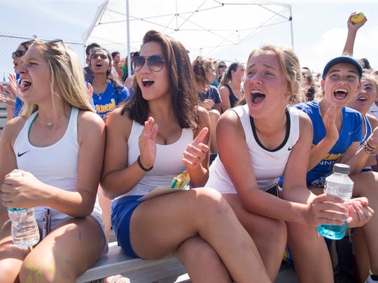 Carmel fans cheer during the IHSAA girls tennis team state finals, from North Central High School, Indianapolis, Saturday, June 2, 2018. The competition was won by Carmel High School.