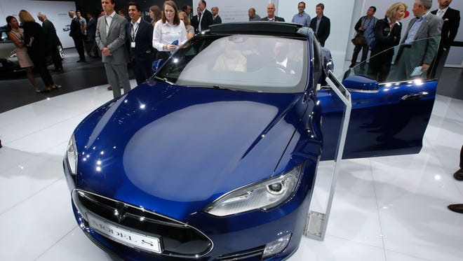 In this Sept. 15, 2015, photo, a Tesla Model S is on display on the first press day of the Frankfurt Auto Show IAA in Frankfurt, Germany. Tesla Motors is working on modifications to its Autopilot system after a fatal crash in Florida. CEO Elon Musk indicated on Twitter that Tesla is working on improvements to the radar the system uses.