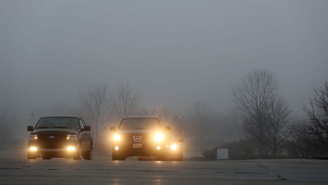 Drivers wait for a traffic light near Winton Woods Park on Wednesday morning.