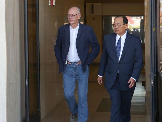 John Wessman, left, leaves the Larson Justice Center