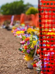Flowers sit in holding area at the Cedar City Cemetery,
