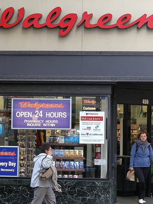 File photo taken in 2012 shows passersby outside a Walgreens store in San Francisco, California.