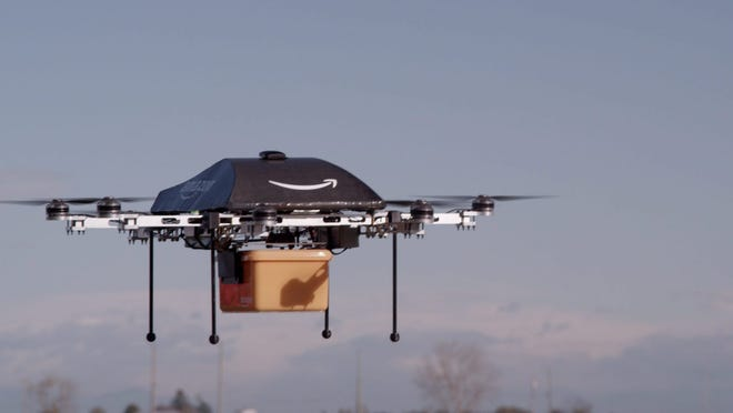 epa03974235 A undated handout image made available by Amazon on 02 December 2013, showing an octocopter drone with an Amazon logo on it, transporting a box. Online retailer Amazon is testing drones to deliver packages, chief executive Jeff Bezos said 01 December 2013 but admitted it could be several years before they would be put to use. The so-called octocopter would be able to deliver packages to consumers within 30 minutes, Bezos told broadcaster CBS' programme 60 Minutes Sunday. The unmanned aerial devices would only be used for small, urgent orders to be delivered within short distances, he said. The eight-propeller drones could transport packages weighing up to 2.5 kilograms and about 16 kilometres away from a distribution centre, Bezos said. But more testing was needed, he said, as well as the approval of the US Federal Aviation Administration. And while Bezos expected to offer the service only in four to five years, he already has a name for it: Prime Air.  EPA/AMAZON / HANDOUT  HANDOUT EDITORIAL USE ONLY/NO SALES ORG XMIT: AMA01