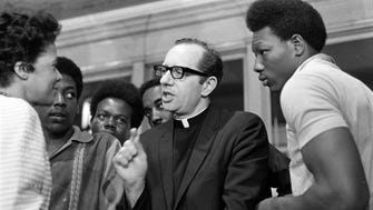 Ald. Vel Phillips (left) and Father E. James Groppi Jr. (center) confer after the Common Council finally passed an open housing ordinance on April 30, 1968. Listening in were several NAACP Youth Council Commandos, including Lawrence Friend (right) president of the council. This photo was published in the May 1, 1968, Milwaukee Journal.