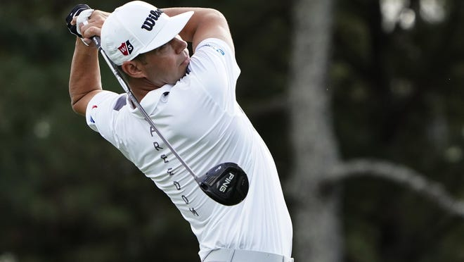 Gary Woodland tees off on Augusta National Golf Club's third hole during a practice round Monday for the Masters. Woodland is ending a two-week layoff after withdrawing from his last tournament with a back injury resulting from a previous hip injury.