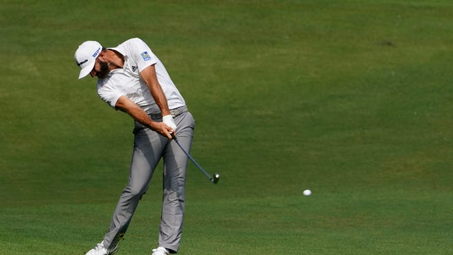 FILE - Dustin Johnson hits on the second fairway during the third round of the Masters golf tournament in Augusta, Ga., in this  Saturday, Nov. 14, 2020, file photo. His 5-iron set up eagle and was a pivotal shot in his victory. (AP Photo/Matt Slocum, File)