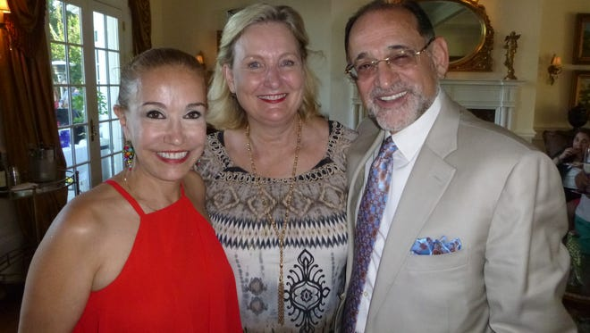 Nazzy and Hash Hashemian recently hosted the East Tennessee Regional Leadership Association team at their home in West Knoxville at a dinner and reception. Photographed here at happy hour are Nazzy Hashemian with Sandi Swilley and Hash Hashemian.