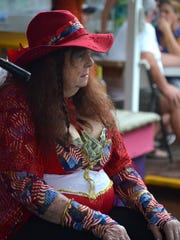 """""""Queen Mary"""" Martin sits onstage at Stan's Idle Hour"""