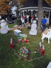 Volunteers decorate Adams Street Park in Port Clinton, Ohio, early for Christmas for a boy battling an aggressive form of cancer.