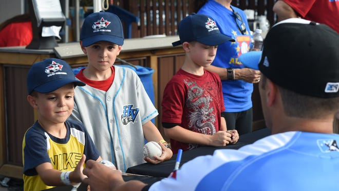 Hudson Valley Renegade Joe Serrapica hands Anthony Christofora of Woodstock his ball during an autograph session prior to the start of the New York Penn League All Star Game at Dutchess Stadium on Tuesday.