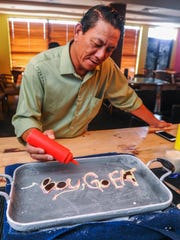 "Pacific Daily News reporter Jojo Santo Tomas tries his hand at creating a more personalized frozen treat during a demonstration of ""anti-grilling"" by Chef Eddie Chien at the Delmonico by Kitchen & Bar restaurant in Tumon on July 2.