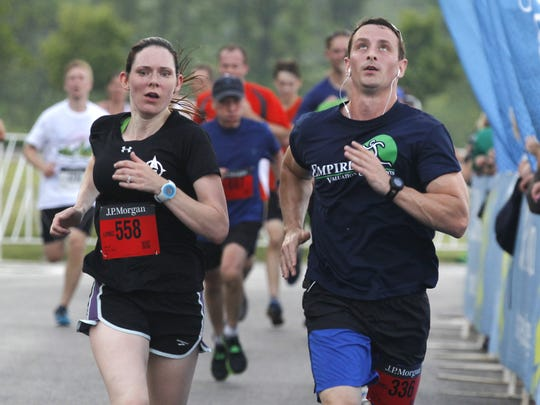 Runners finish the Chase Corporate Challenge at RIT.