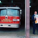 Richmond firefighter Tim Brown carries the last few items from Fire Station No. 6 on North West Fifth Street on the day it closed in 2009.