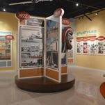 The exhibit captures the style of the era, right down to a vintage TV set in this recreation of a Deltona sales office.