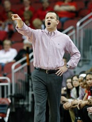 U of L head coach Jeff Walz instructs his team against UT Martin during their game at the KFC Yum! Center.Dec. 28, 2015