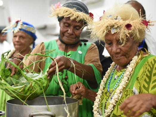 Delegates from New Caledonia prepare various taro-based