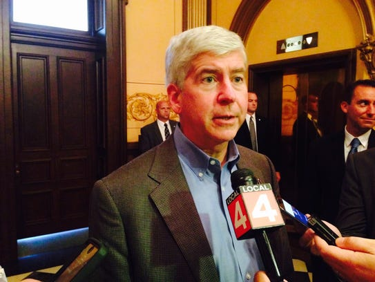 Gov. Rick Snyder talks to the media about Michigan's