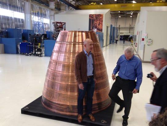 Jeff Bezos, left, founder of Amazon.com and Blue Origin,