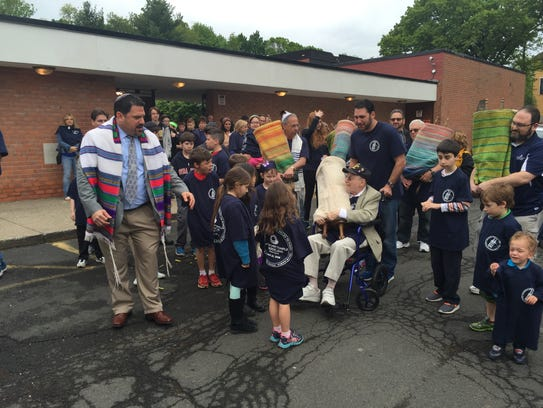 Rabbi Michael Churgel gets children in line as Bill