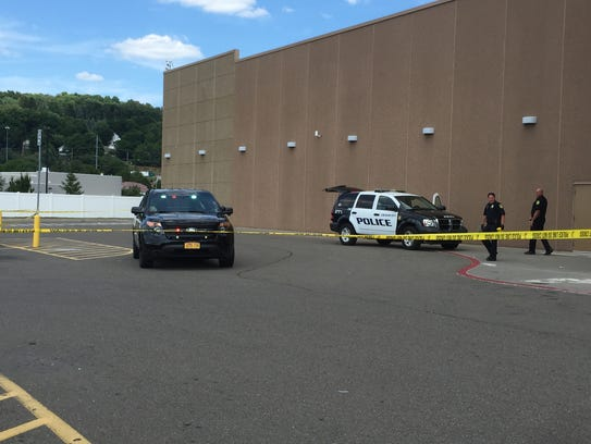 Police officers work behind crime scene tape Tuesday